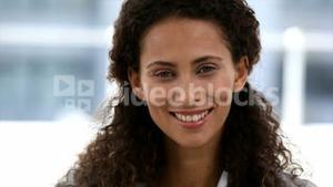 Attractive woman turn around and smile