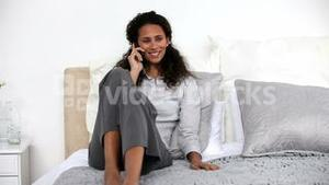 Woman on the phone on the bed