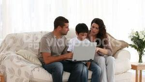 Family playing at a computer