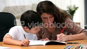 Mom doing homework with her son