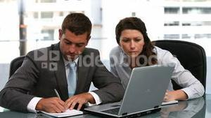 Businesspeople working together on a laptop