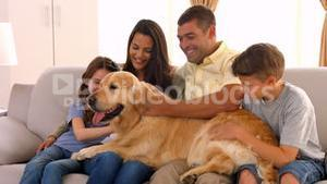 Happy family smiling with their dog