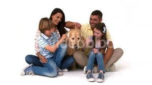 Happy family with their pet dog