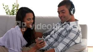 Couple listening to music on the couch