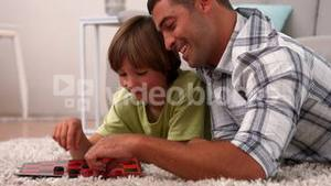 Father and son playing board game