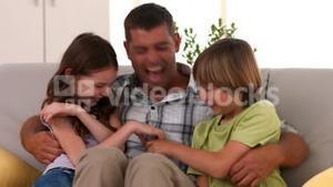 Happy father with his children