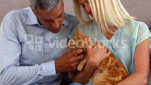 Happy couple with their cat