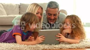 Happy family using tablet together