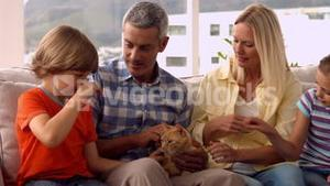 Happy family with pet cat