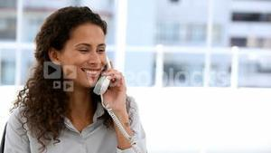 Business woman calling someone on the phone