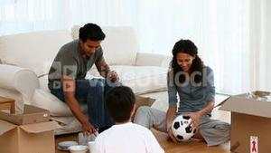 Family playing with a football ball