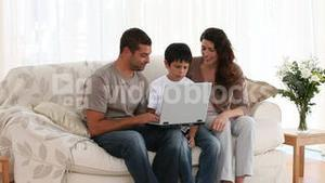 Family playing at a computer game