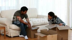 Couple moving their stuff
