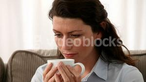 Woman smelling tea or coffee