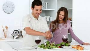 Couple cooking a salad