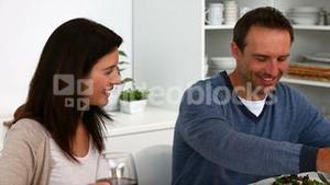 Couple toasting with red wine during the lunch