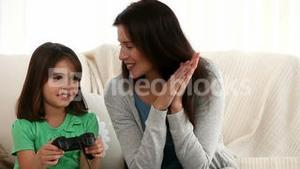 Mother and daughter playing video games