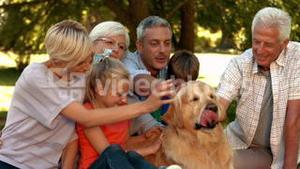 Happy family with their dog in park