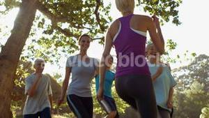 Fitness group exercising in the park