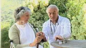 Doctor giving bills to a patient