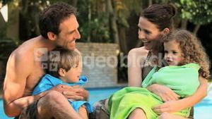 Family laughing after pool