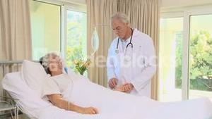 Woman in coma lying on the bed with an oxygen mask