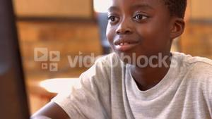 Pupil in computer class at school