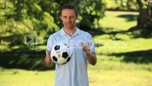 Man juggling with a soccer ball