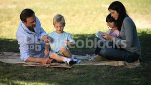 Family looking books and enjoying a good time
