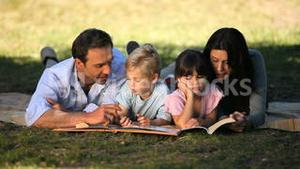 Family looking books and enjoying a good weather