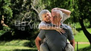 Old man carrying his wife