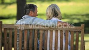 Senior couple relaxing on a bench