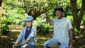 Elderly couple on bikes looking at the way ahead