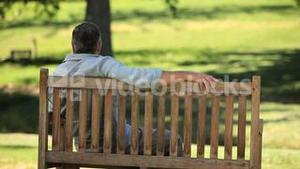 Old man relaxing on a bench