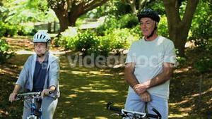 Old man and woman on bikes looking at the way ahead