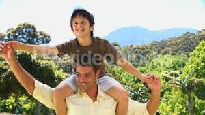 Dad carrying son and enjoying the time together