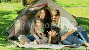 Family looking at the landscape in front of the tent