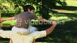 Dad carrying his son and enjoying the time together