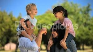 Parents carrying their children and enjoying the time together