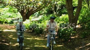 Old woman and man biking together