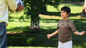 Dad and son playing with a ball