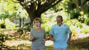 Elderly couple running