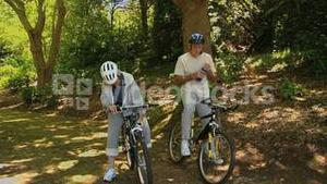 Senior couple with bikes looking at the way ahead