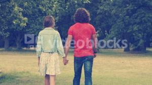 In high quality format happy couple walking in the park