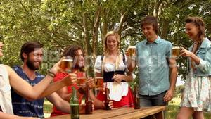 In high quality format group of friends celebrating oktoberfest