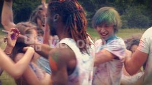 In high quality format happy friends throwing powder paint