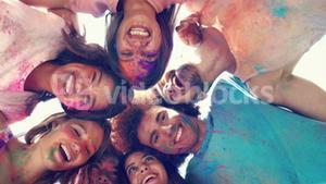 In high quality format happy friends covered in powder paint