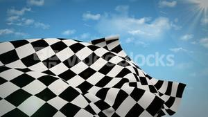 Checkered flag against blue sky