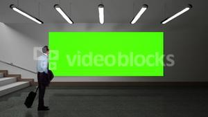 Businessman looking at green screen