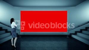 Businesswoman looking at red screen